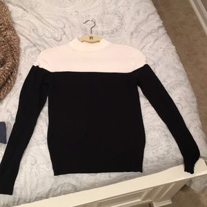 Sleek color block black and white sweater